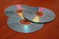 Technology - Compact discs on wooden table